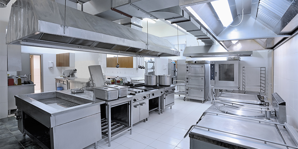 Commercial kitchen full of cooking equipment