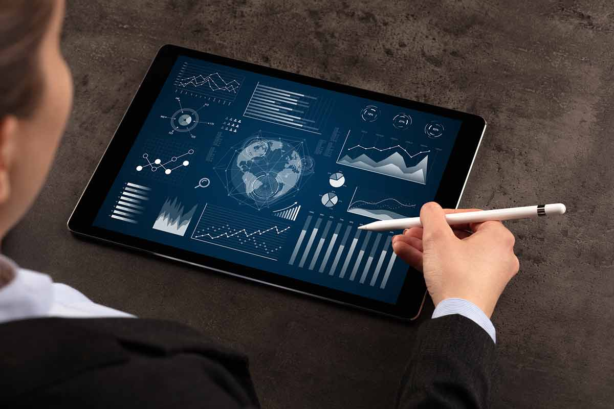 woman manipulating a tablet with graphs and analytics referencing her sensor technology