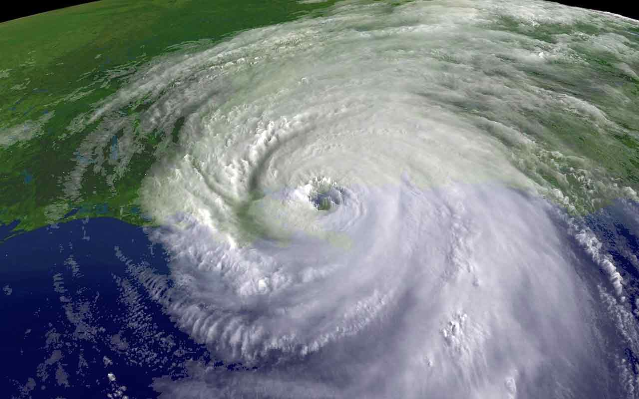 Aerial view of hurricane during hurricane season over commercial buildings in Florida.